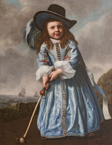 Niño jugando al kolf